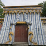 the guards' tent, with draperies meticulously rendered in sheet metal