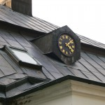 detail of clock on owner's house (with chime, because workers couldn't afford their own watches)